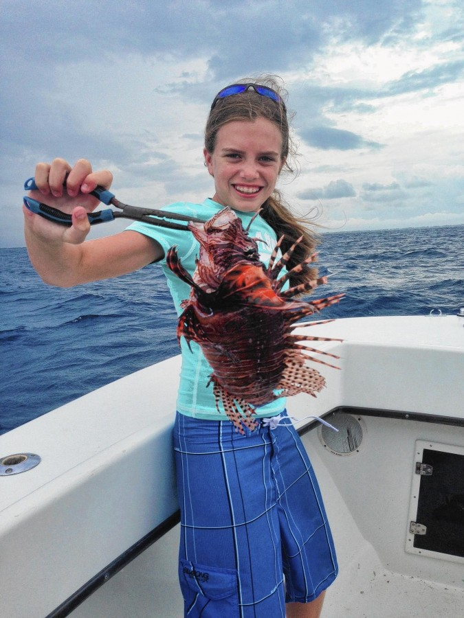 Lauren Arrington holds up a lionfish speared off the coast of Jupiter. (Courtesy of Albrey Arrington, Handout)
